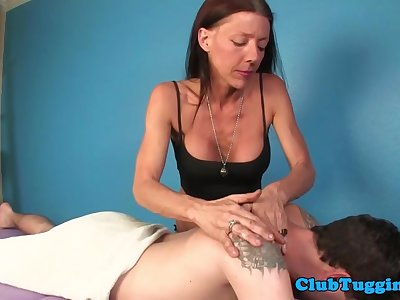 Mature masseuse titfucks clients cock