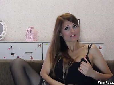 Brunette stripping to black stockings and masturbating in front be expeditious for her webcam