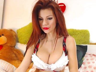 Busty redhead milf masturbating with her dildo on cam