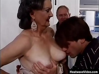 Elderly husband offers his mature wife not far from a young student