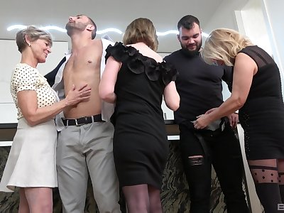 Insolent matures undress and share get under one's lad's big dicks in a crazy home orgy